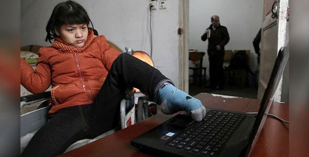 21-year-old Hu Huinyuan suffering from serious cerebral disorder is writing a fiction novel by typing with her left foot's toes.