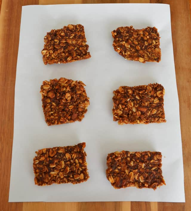 Square pieces of oatmeal, nut, and chocolate bars.