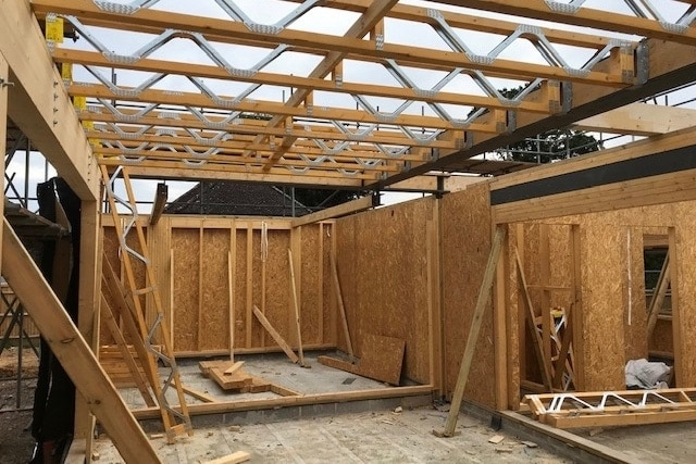 Scandia Hus new build in progress, shell construction with no ceiling before MVHR system fitted by SubCool FM