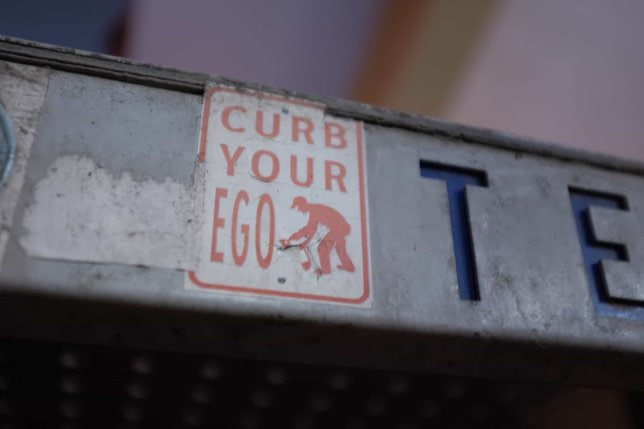 curb your ego sign