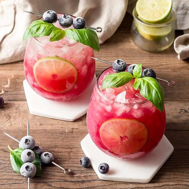 Basil Blueberry Margaritas on White Marble Coasters