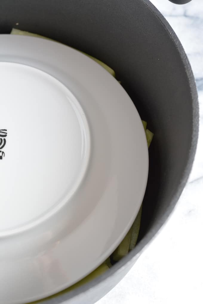 A white place inside of a large black pot.