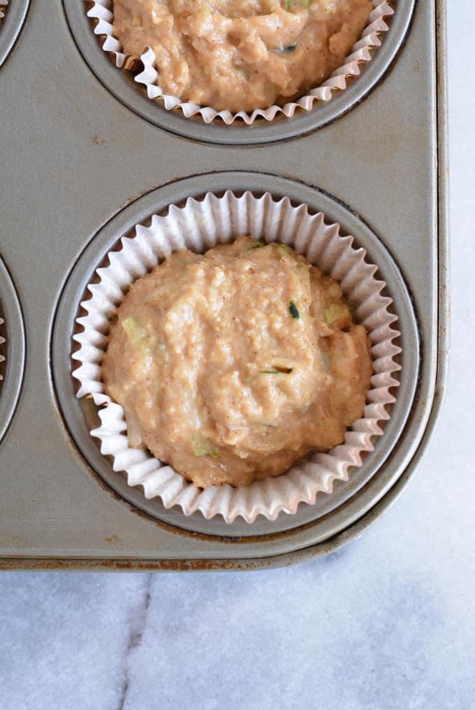 Muffin batter in a muffin pan.