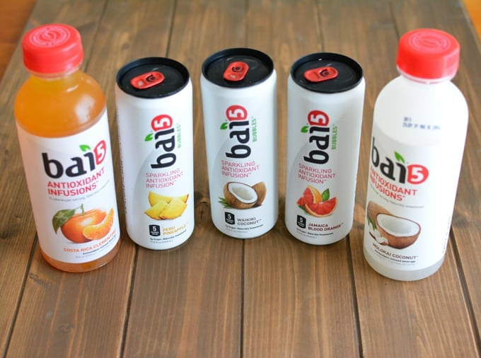 Two bottles and 3 cans of Bai fruit-flavored drinks.