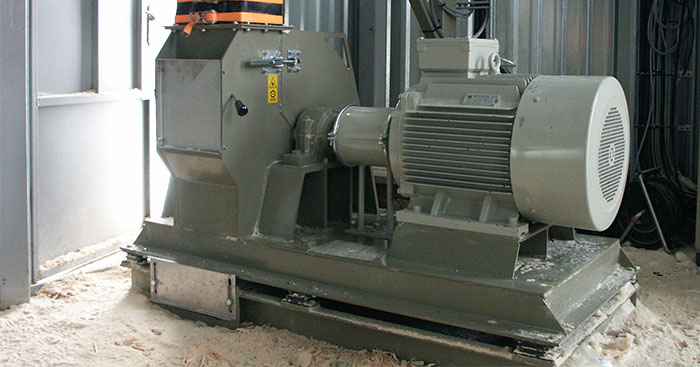 Hammermill for woodworking scrap made to re-shred wood into briquette material