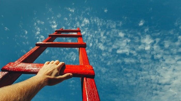 climbing ladder into sky