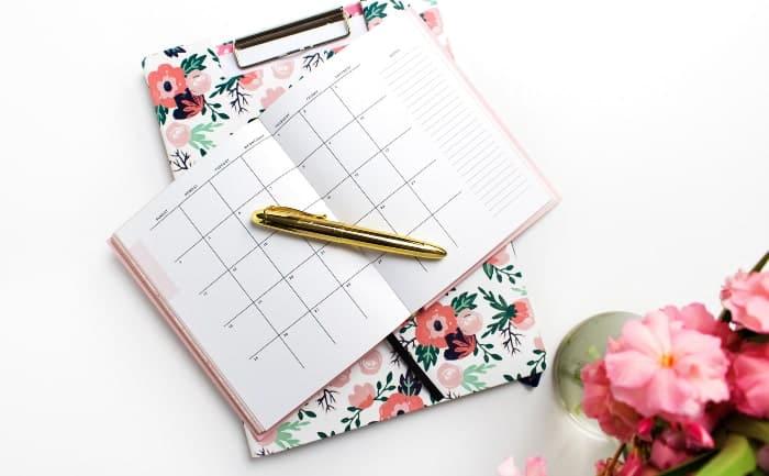 empty pink agenda with pen