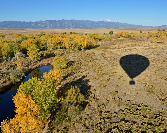Shadow of Hot Air Balloon over a lake and plains in Colorado Springs