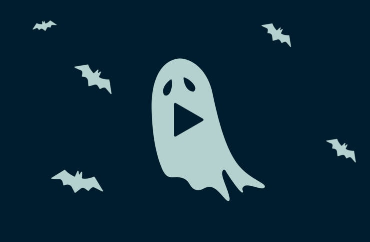 A ghost with a play symbol for a mouth, and multiple bats.