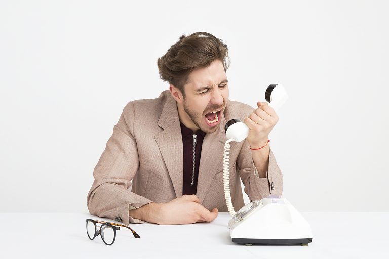 Frustrated man shouting into phone