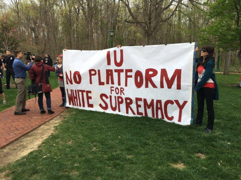 """Students holding a banner that reads """"IU No Platform for White Supremacy"""""""