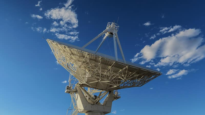 Satellite of the VLA pointed towards the blue clouded sky