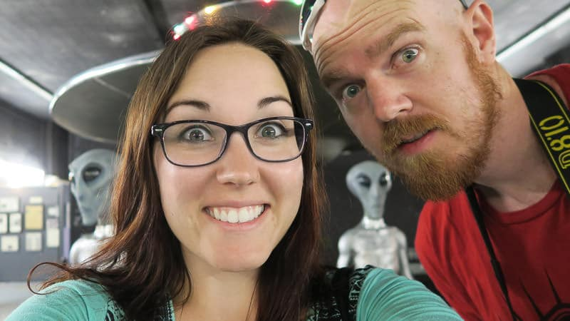 Brooke and Buddy posing with the alien exhibit at the roswell UFO Museum