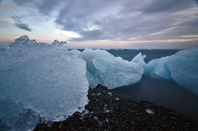 Ice chunks on the black sand beach near the glacier lagoon