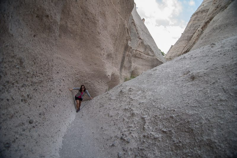 Brooke hiking through a slow canyon at Kasha-Katuwe Tent Rocks National Monument