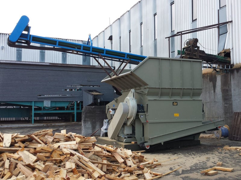 Hopper Shredder With Custom Band Conveyor And Off Cut Wood In Foreground