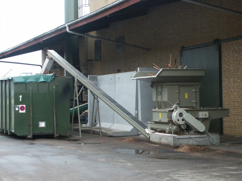 Scanhugger With Auger Conveyor Feeding Into A Container