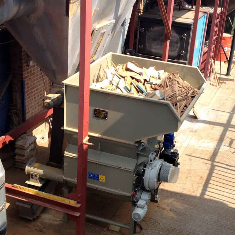 Industrial wood shredder for wood waste recycling - Scanhugger HL 4/14/13 at wood fabrication site