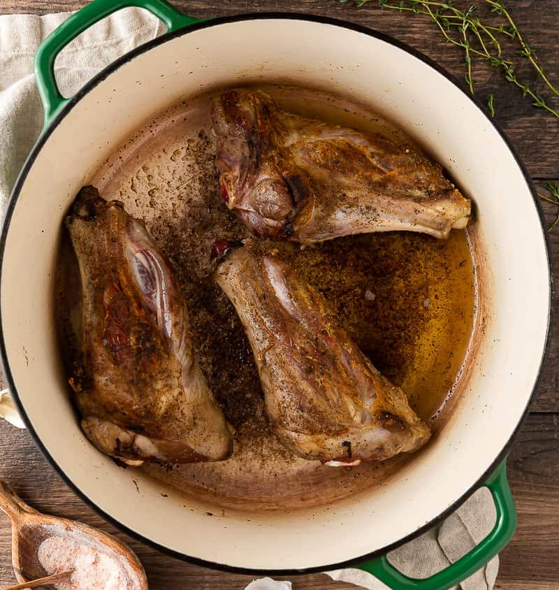 lamb shanks browning in dutch oven