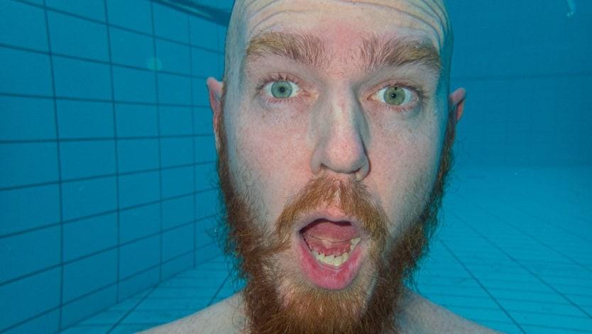 buddy goofing off under water