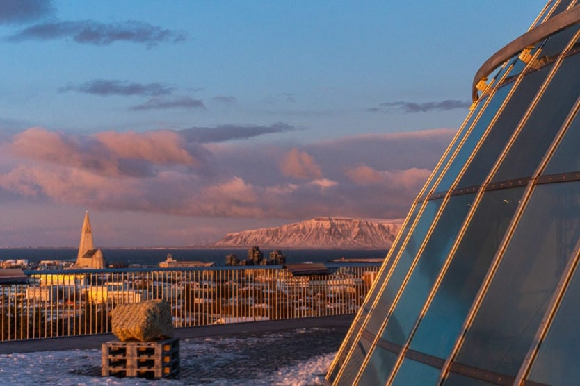 Some of the dome of the Perlan Museum with Hallgrimskirkja Church and Esja in the distance