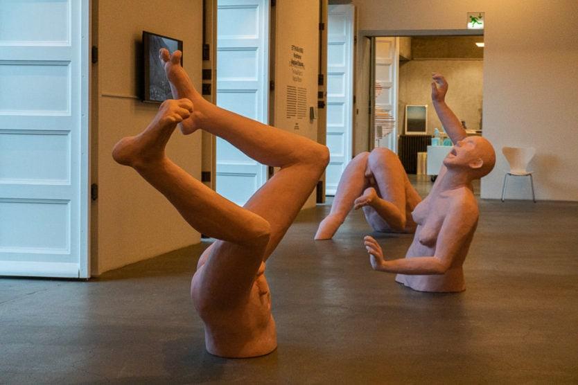 Hafnarhús - Reykjavík Art Museum bodies coming out of ground exhibit