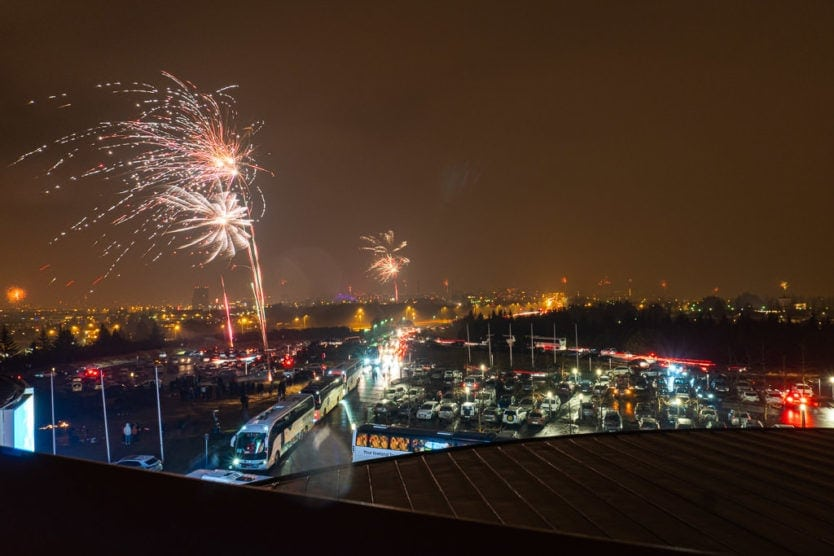 parking lot at perlan on new year's eve with fireworks