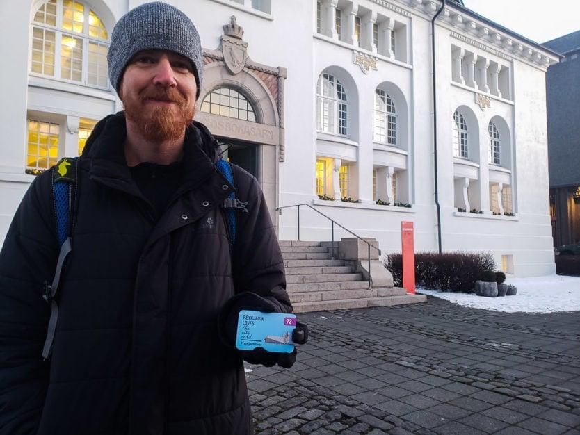 buddy holding reykjavik city card outside one of the reykjavik museums