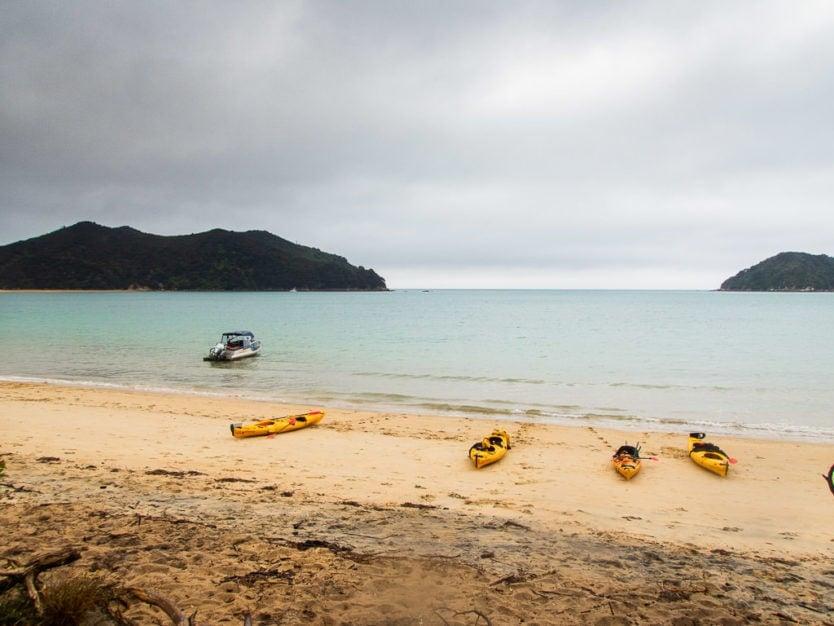 kayaks on the beach at Onetahuti bay