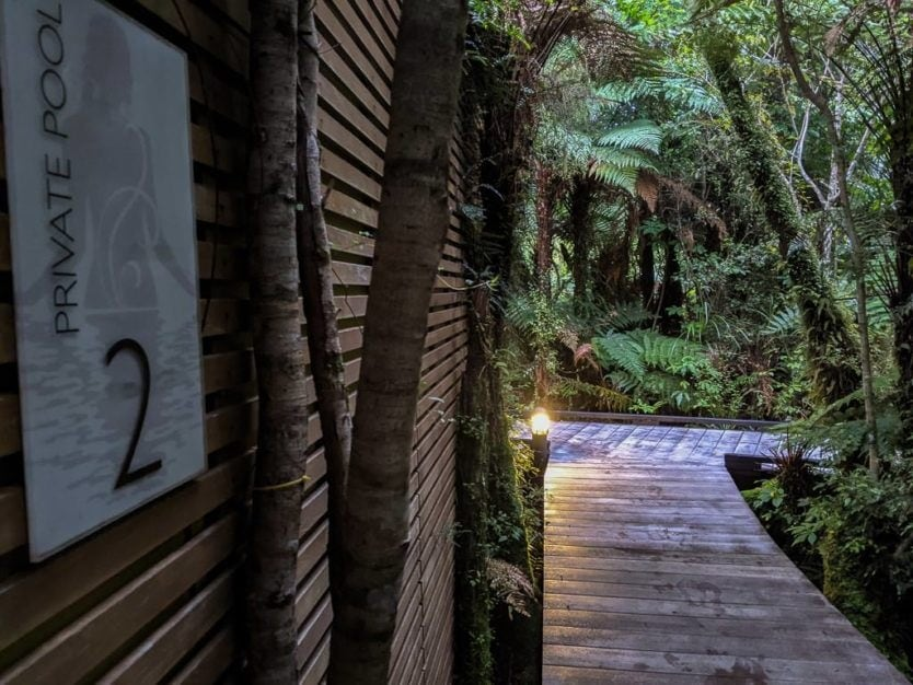 entry to a private pool at the franz josef glacier hot pools a peaceful new zealand hot spring
