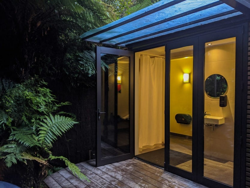 private shower, toilet and changing area in a private pool at the franz josef glacier hot pools a peaceful new zealand hot spring