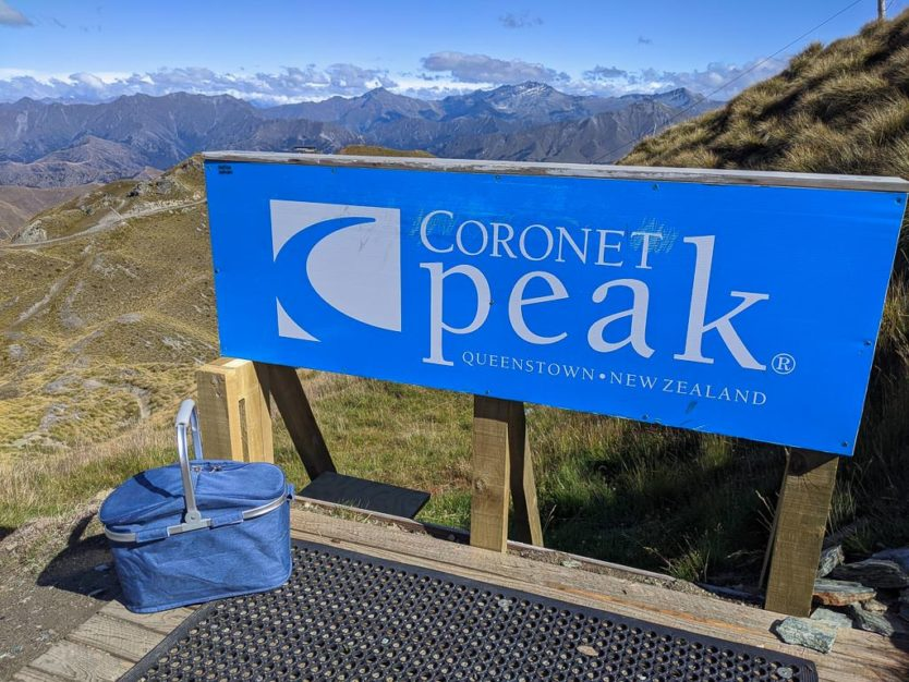picnic basket with mountain views from atop coronet peak