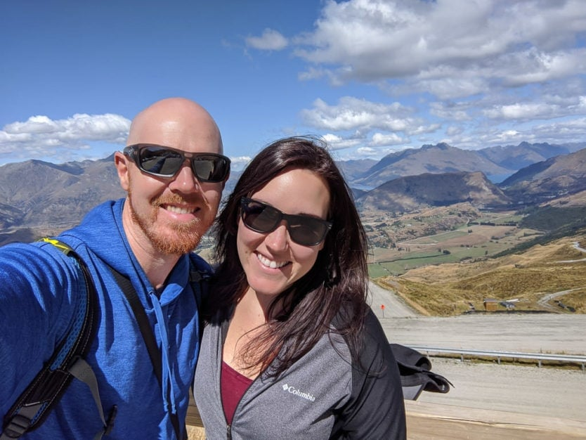 couple with mountain views from atop coronet peak