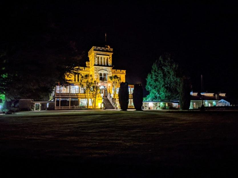 larnach castle in dunedin at night with gardens