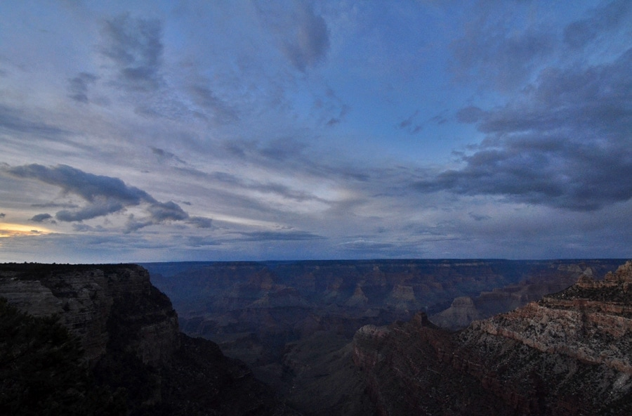 Sunset at the grand canyon with whispy clouds