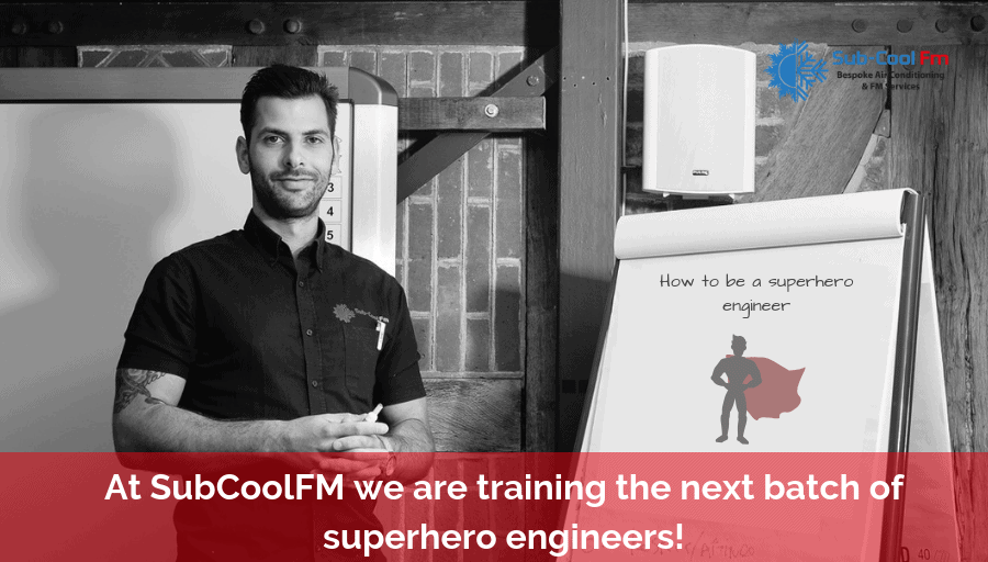 """Jacob stood in front of a flip chart that reads """"How to be a superhero engineer"""""""