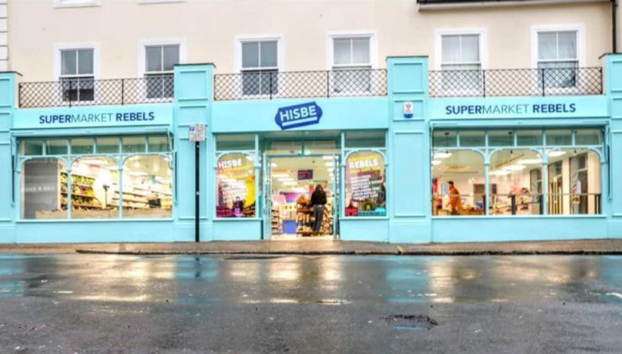 Hisbe ethical supermarket full exterior lit up on Worthing Street with Panasonic Nanoe-X air conditioning by SubCool FM