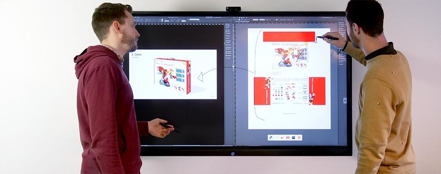 séance de travail de designers sur un écran tactile géant