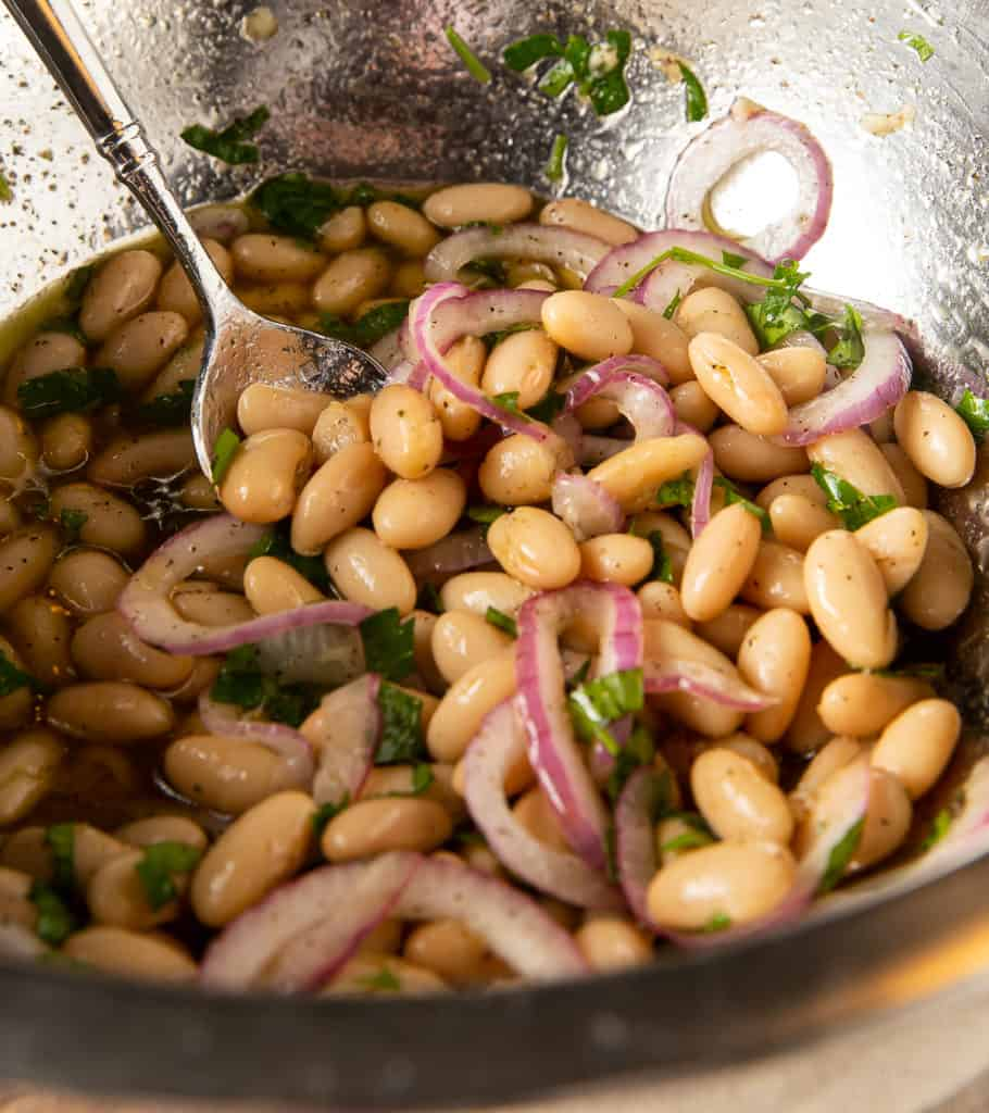 marinated white beans make the broccolini salad dressing