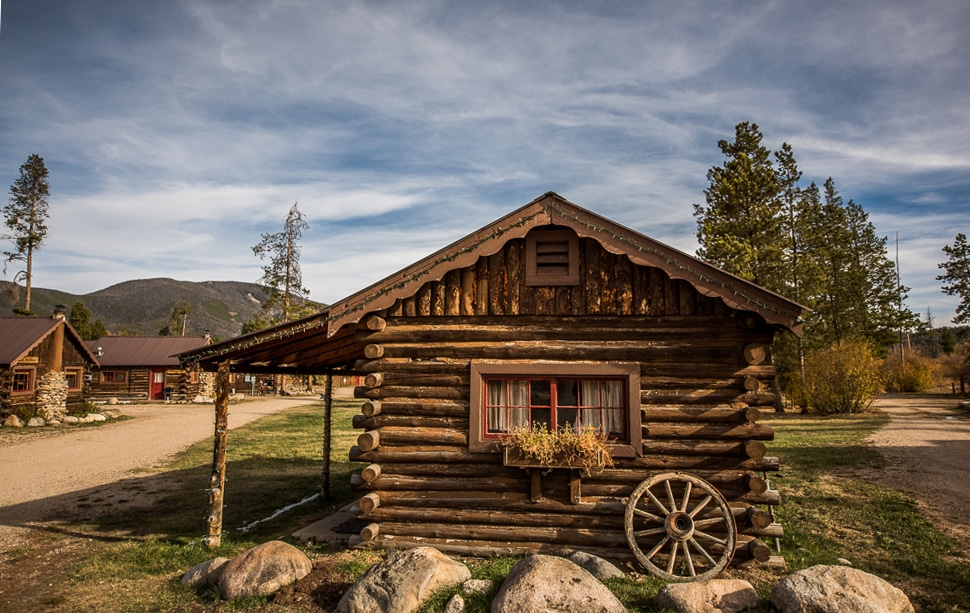 Grand Lake Cabin Rental by Colorado Cabin Adventures with mountains in the background