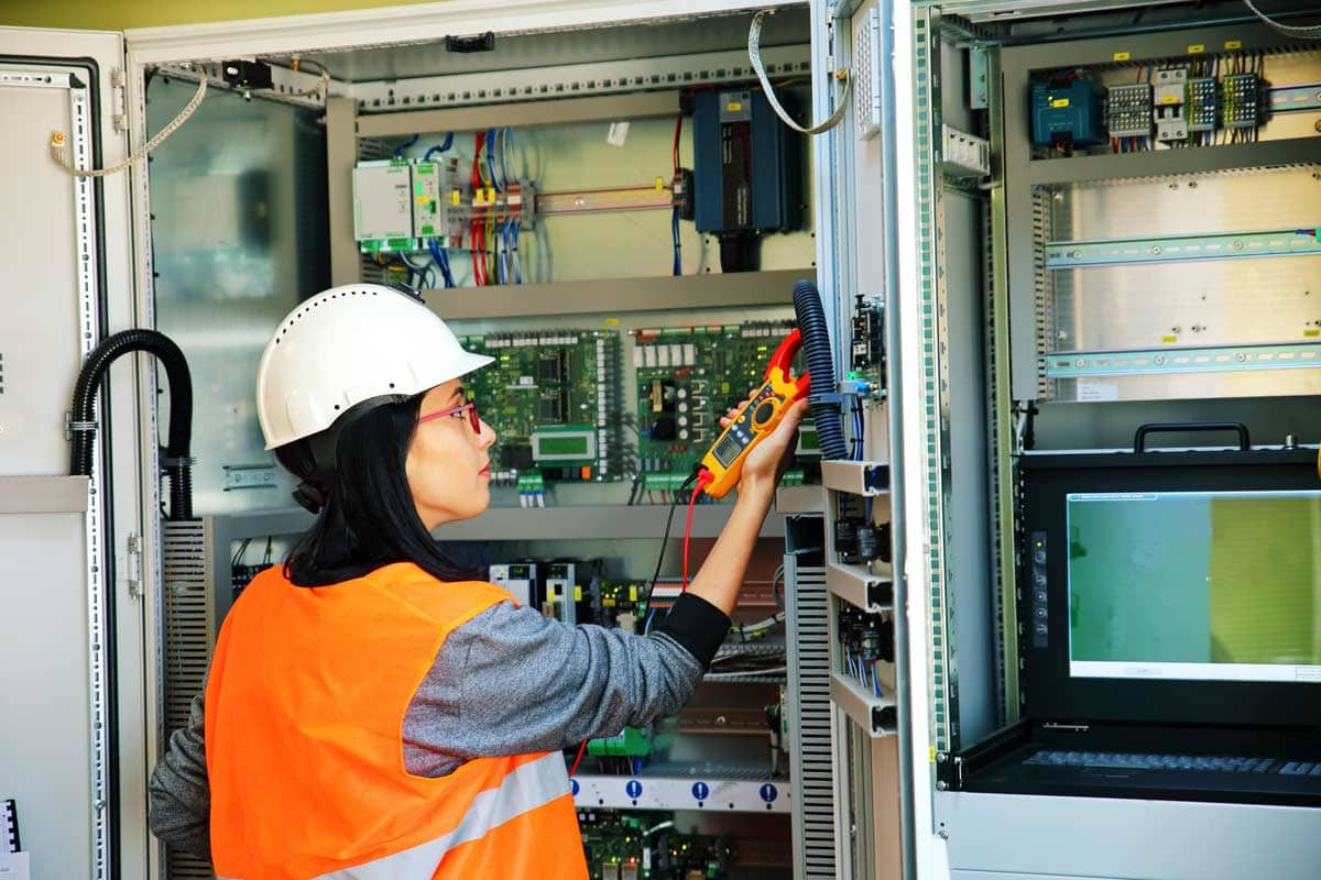 Worker testing electrical equipment at Spike Electric