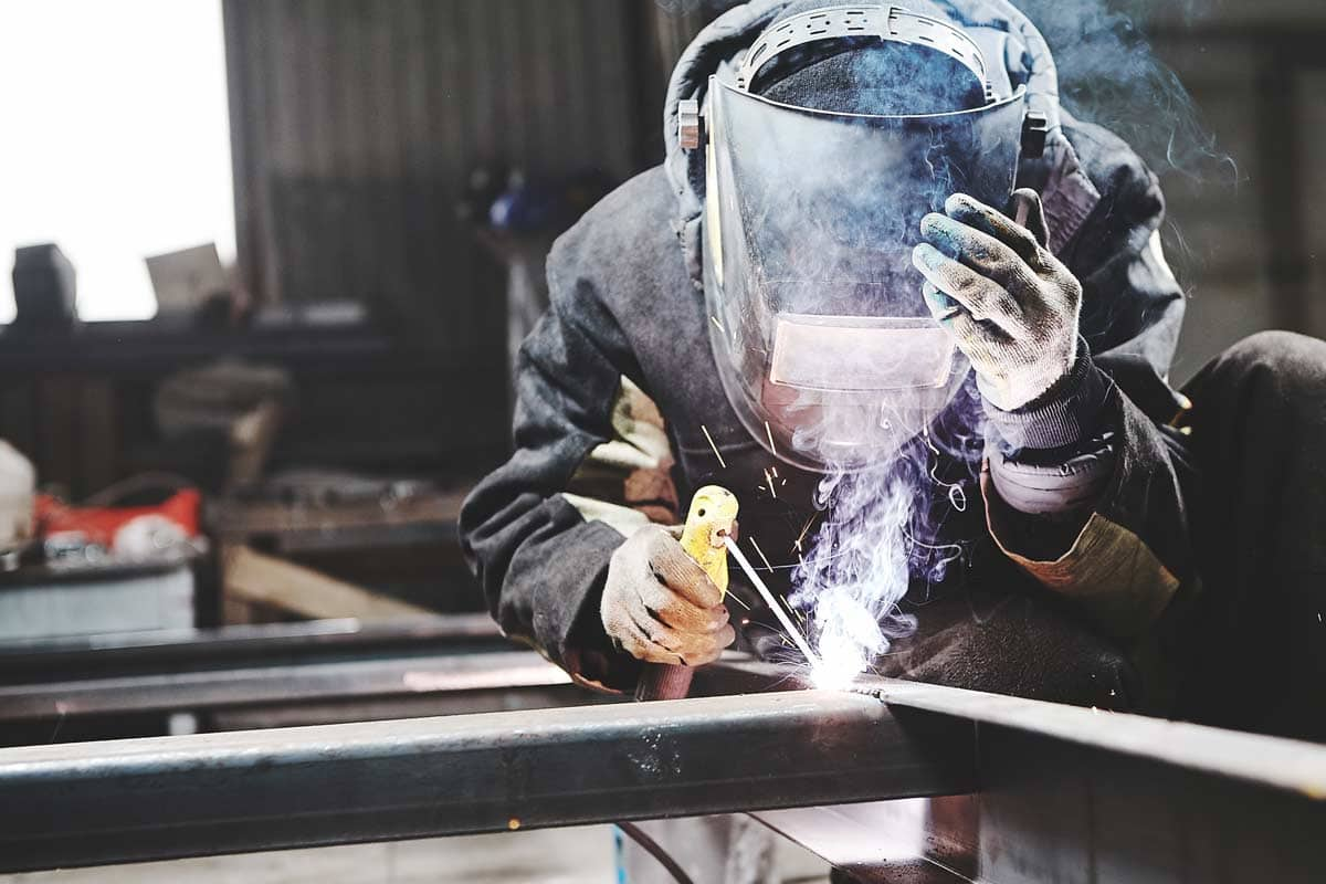 man welding at spike electric