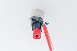 Automatic smoke detector fire alarm head on the ceiling. The smo