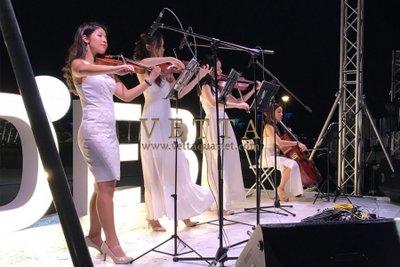 All ladies String Quartet performing on stage at Diner En Blanc Singapore