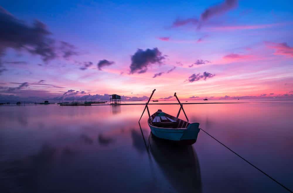 minimal photo of a boat at dusk