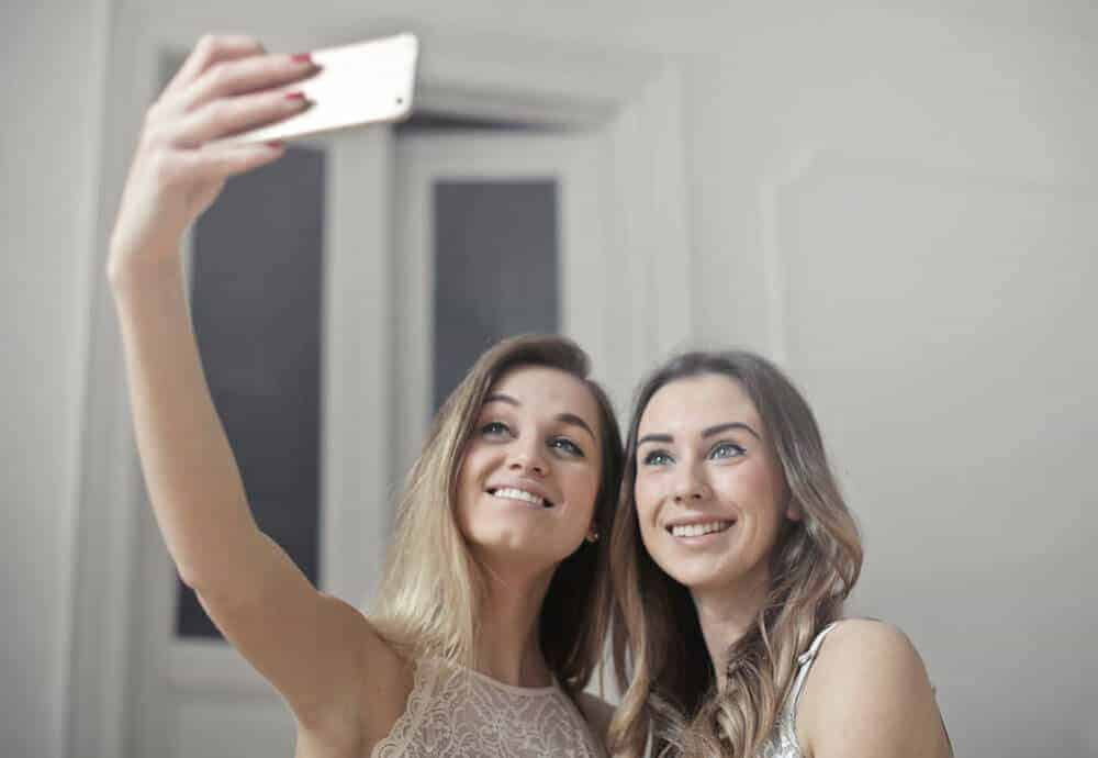 holding smartphone above for better photo
