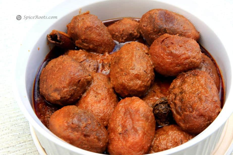 Deep fried potatoes cooked in a spicy sauce also known as Kashmiri dum aloo