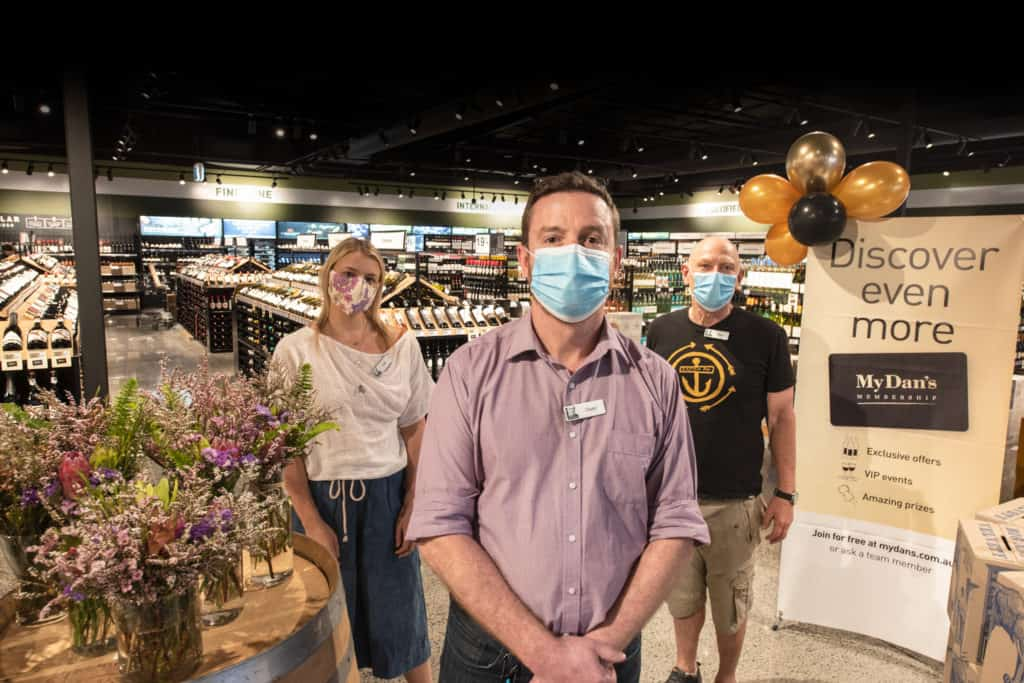workers wearing face mask in liquor store