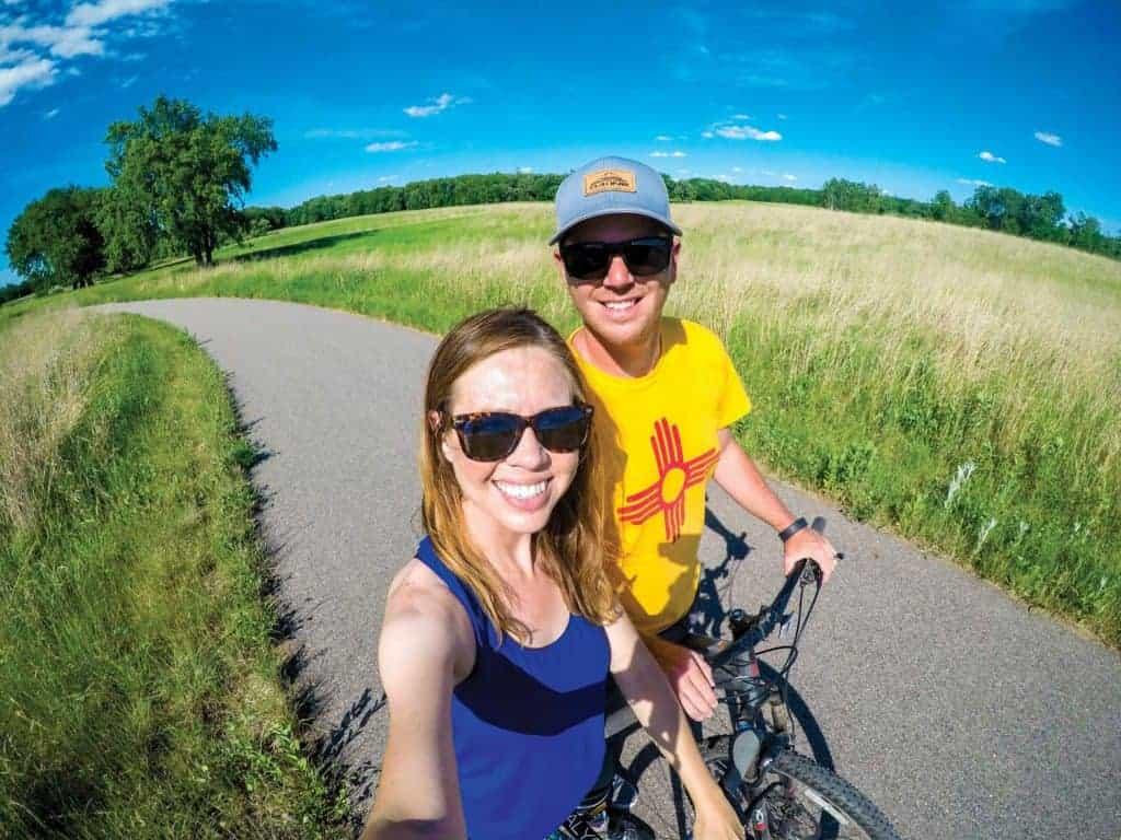 Jenna and Micah Kvidt pedaling on the bike look trail at Glendalough State Park.
