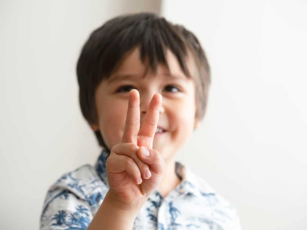 Child counting on fingers